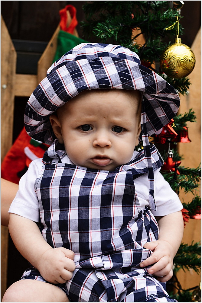 baby boy dressed in Keedo dungarees with matching hat for Christmas