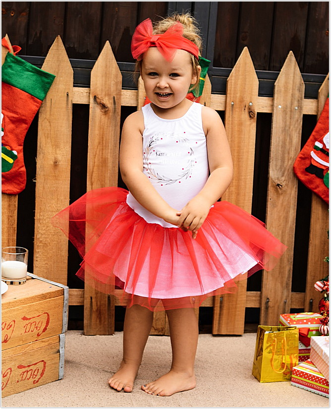 toddler girl in red and white tutu dress with headband from keedo